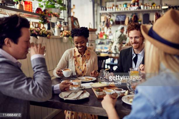 friends at a restaurant - brunch stock pictures, royalty-free photos & images