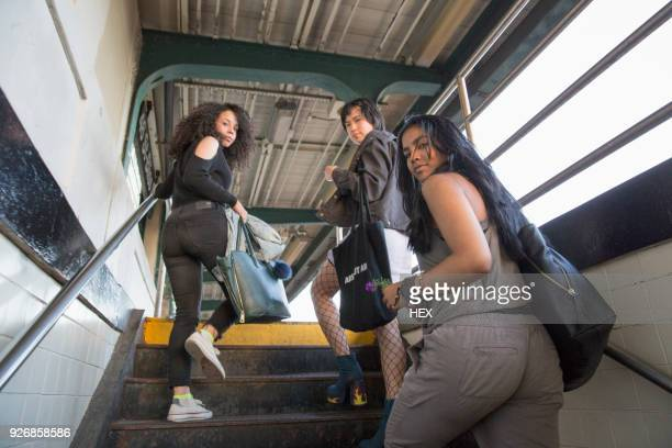 friends at a train station in queens, new york - queens new york city stock pictures, royalty-free photos & images
