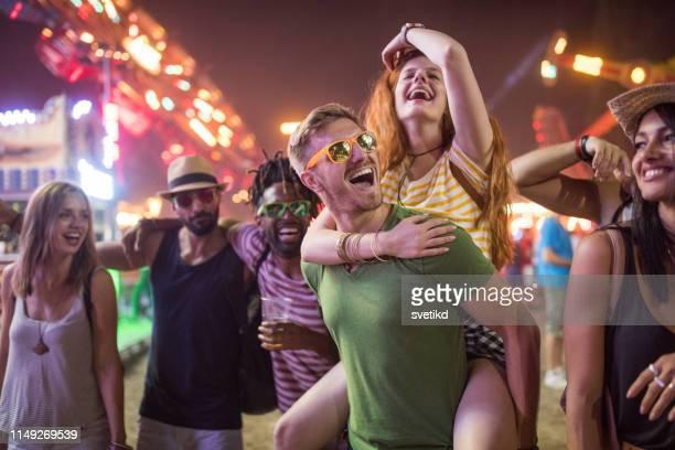 friends at amusement park - festival goer stock pictures, royalty-free photos & images