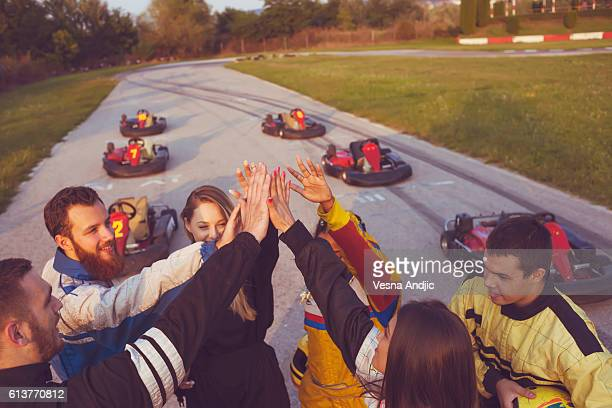 friends at amusement park - motorsport stock pictures, royalty-free photos & images