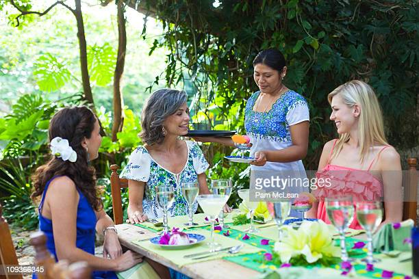 friends at an resort restaurant in mexico. - merida mexico stock photos and pictures