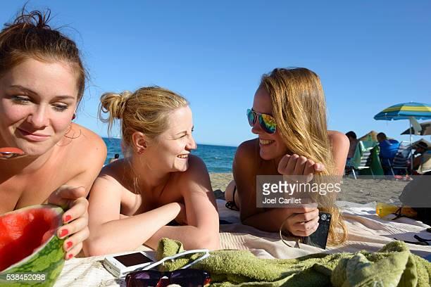 Friends at beach in Malaga, Spain