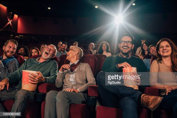 friends at cinema - comedy film stock photos and pictures