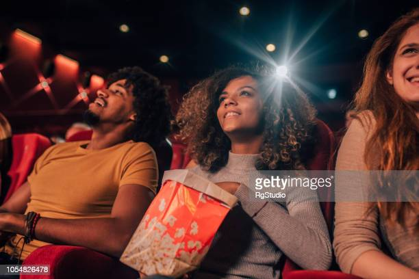 friends at cinema - film screening stock pictures, royalty-free photos & images