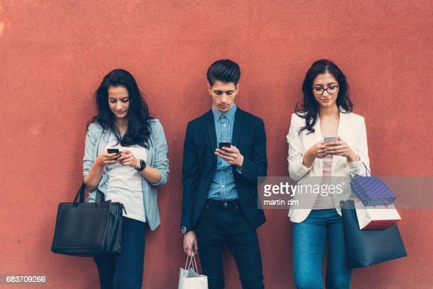 Friends at colorful wall texting