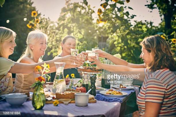 Friends at dinner party in garden