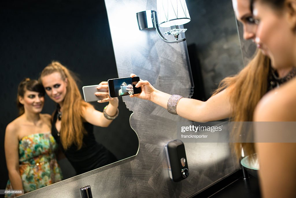 Friends at disco club take a selfie : Stock Photo