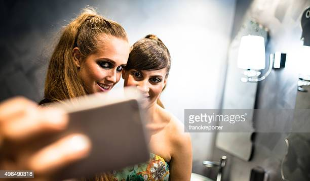 Friends at disco club take a selfie
