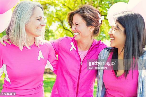 Friends at finish line of breast cancer awareness charity race