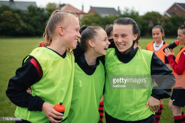 friends at football practice - team sport stock pictures, royalty-free photos & images