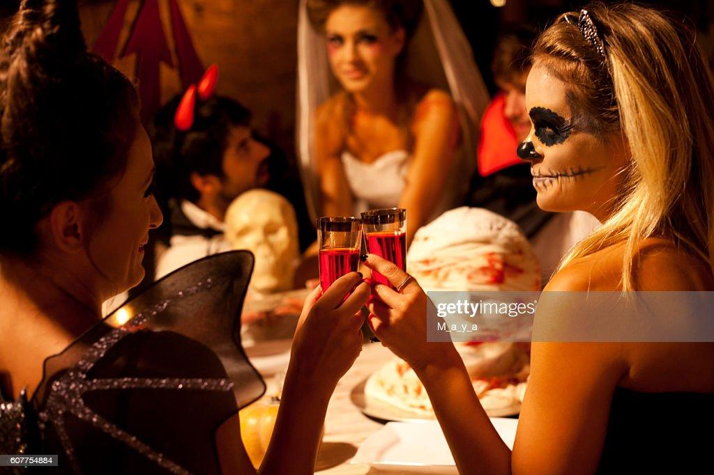 Friends at Halloween dinner : Stock Photo