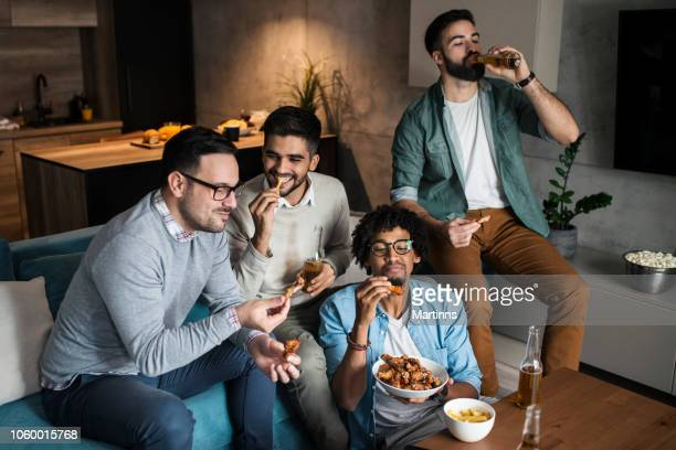 Friends at home eating fast food
