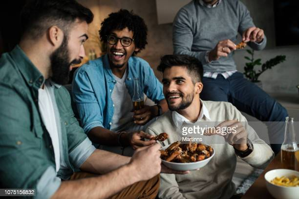 friends at home eating fast food - chicken wings stock pictures, royalty-free photos & images