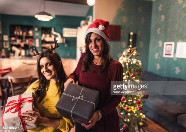 friends at home with the christmas presents