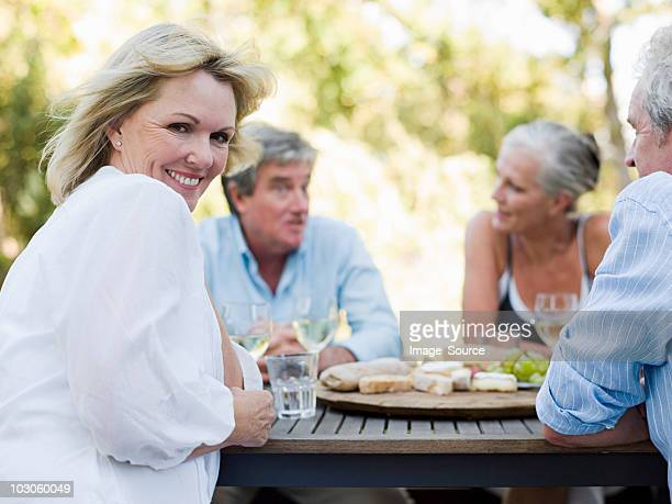 friends at meal outdoors - 50 59 years stock pictures, royalty-free photos & images