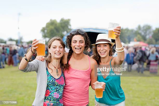 friends at music festival toasting and laughing. - south east england stock pictures, royalty-free photos & images