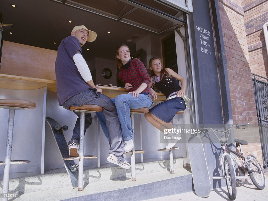 Friends at sidewalk caf? : Stock Photo