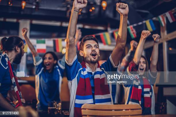 friends at sport bar - match sport stock pictures, royalty-free photos & images