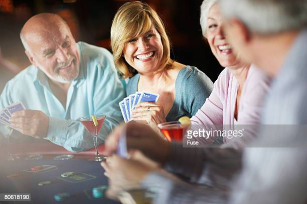 friends at table in casino - gambling table stock pictures, royalty-free photos & images