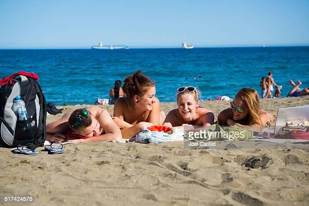 Friends at the beach in Malaga, Spain