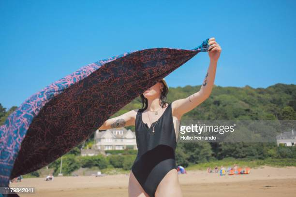 friends at the beach - swimwear stock pictures, royalty-free photos & images