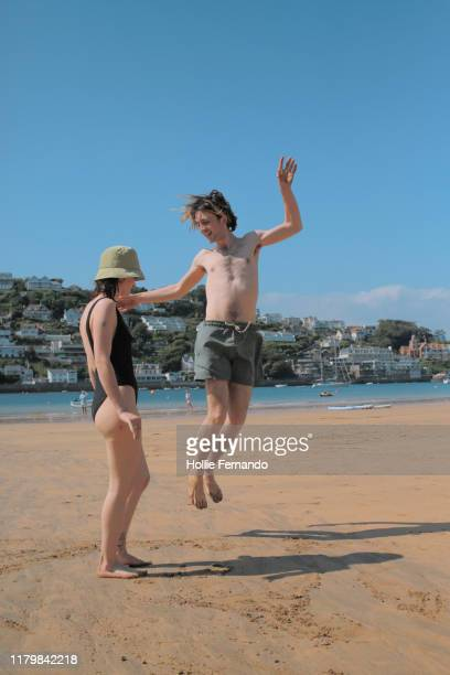 friends at the beach - beach stock pictures, royalty-free photos & images