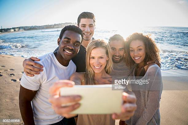 Friends at the beach taking a selfie