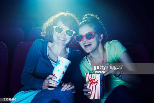 friends at the cinema wearing 3d glasses - her 2013 film stock photos and pictures