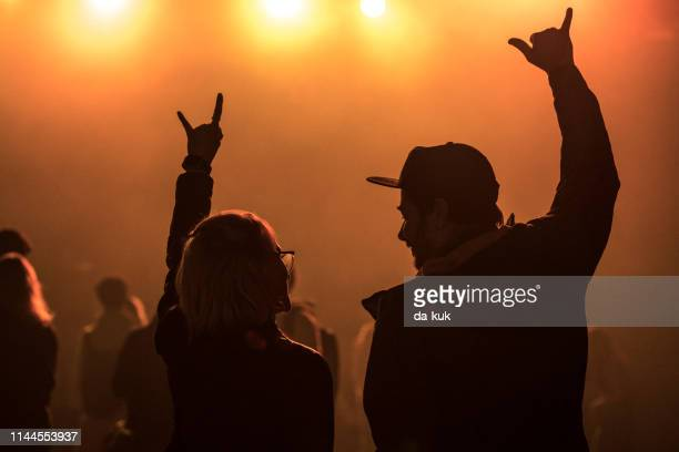 friends at the concert / music festival - heavy metal stock pictures, royalty-free photos & images