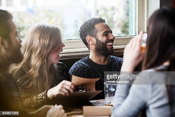 friends at the local pub - pub stock pictures, royalty-free photos & images