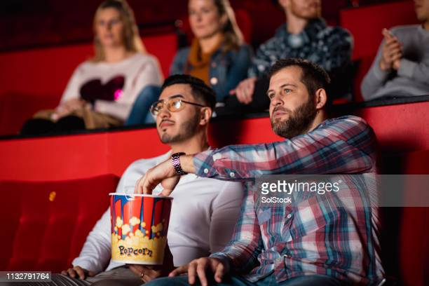 friends at the movies - film screening stock pictures, royalty-free photos & images