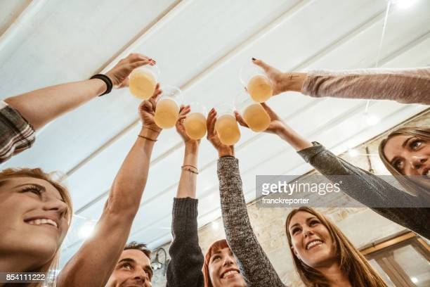 friends at the ocktoberfest - beer stein stock photos and pictures