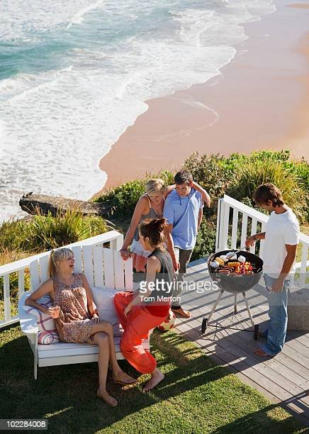 friends barbecuing - barbecue social gathering stock pictures, royalty-free photos & images