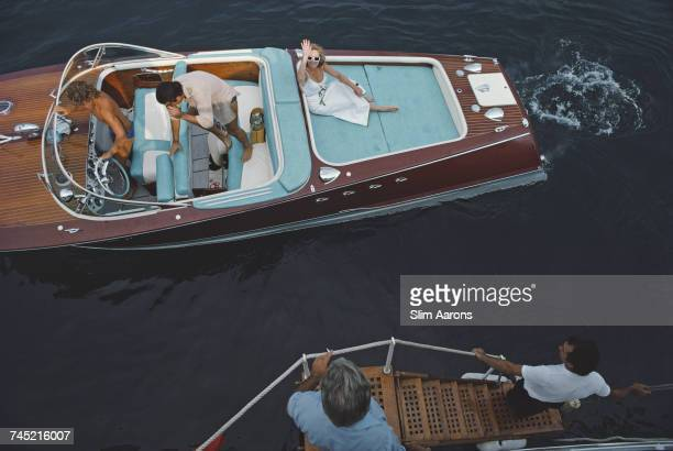 Friends board a riva boat in Monte Carlo, Monaco, 1975.