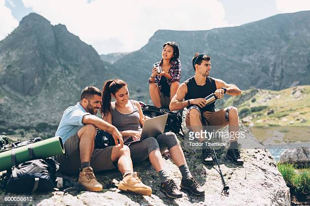 Friends browsing the net in the mountain
