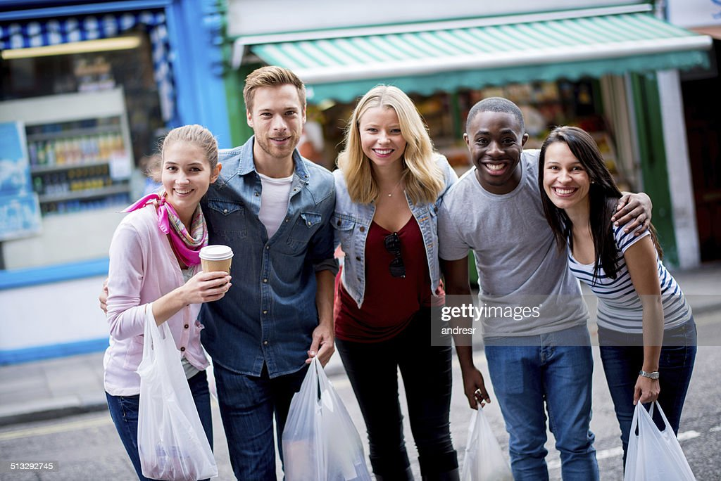 Friends Buying Groceries High-Res Stock Photo - Getty Images