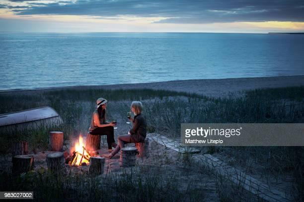 friends camping at sandy beach in ontario, canada. - ontario canada stock-fotos und bilder
