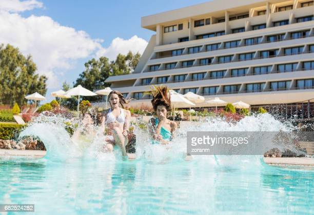 friends cannon jumping into pool - cannon stock pictures, royalty-free photos & images