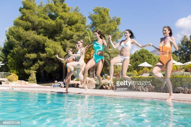 Friends cannon jumping into pool