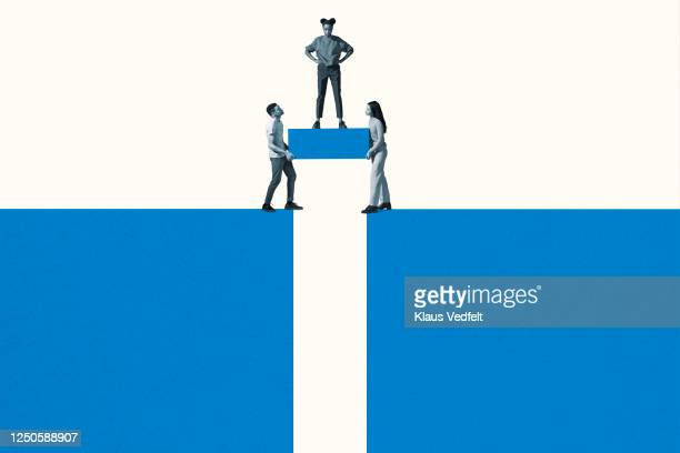 friends carrying block while woman standing on it - strength stock pictures, royalty-free photos & images