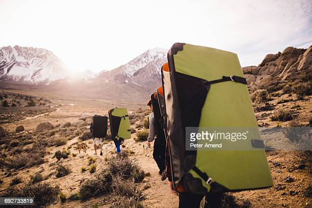 Friends carrying bouldering mats, Buttermilk Boulders, Bishop, California, USA