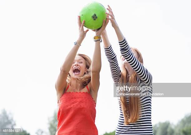 Friends catching football