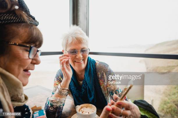 friends catching up in a cafe - showus stock pictures, royalty-free photos & images