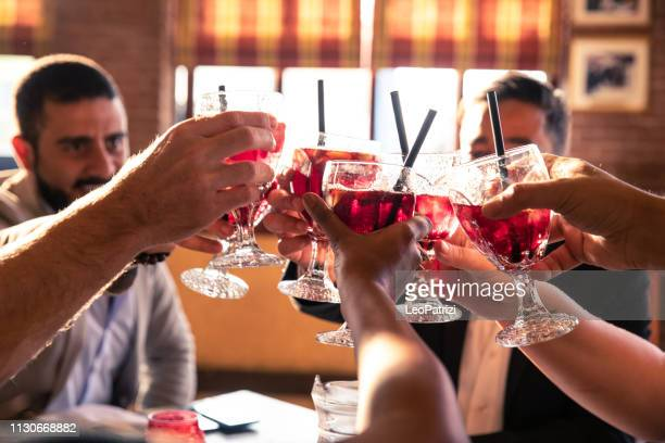 friends celebrate a birthday enjoying sangria - sangria stock pictures, royalty-free photos & images