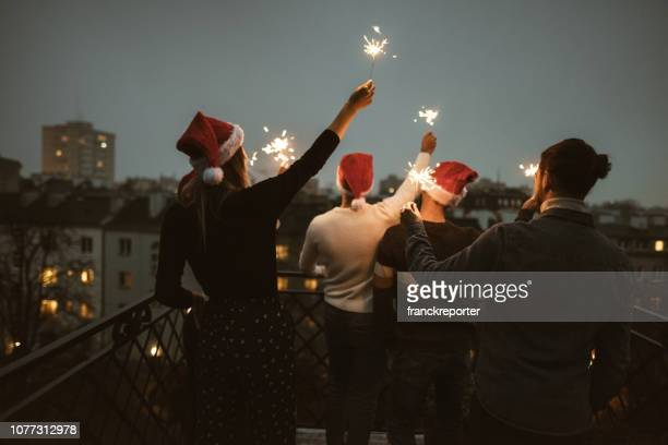 friends celebrate the christmas on the rooftop - christmas stock pictures, royalty-free photos & images