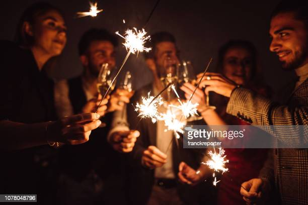 friends celebrate the new year on the rooftop - 2020 stock photos and pictures