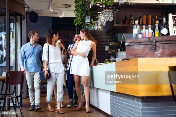 Friends celebrating a party in a cafe