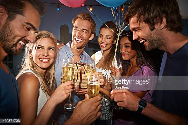Friends celebrating at birthday party