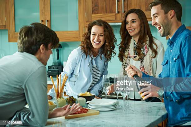 friends celebrating at home - snack stock pictures, royalty-free photos & images