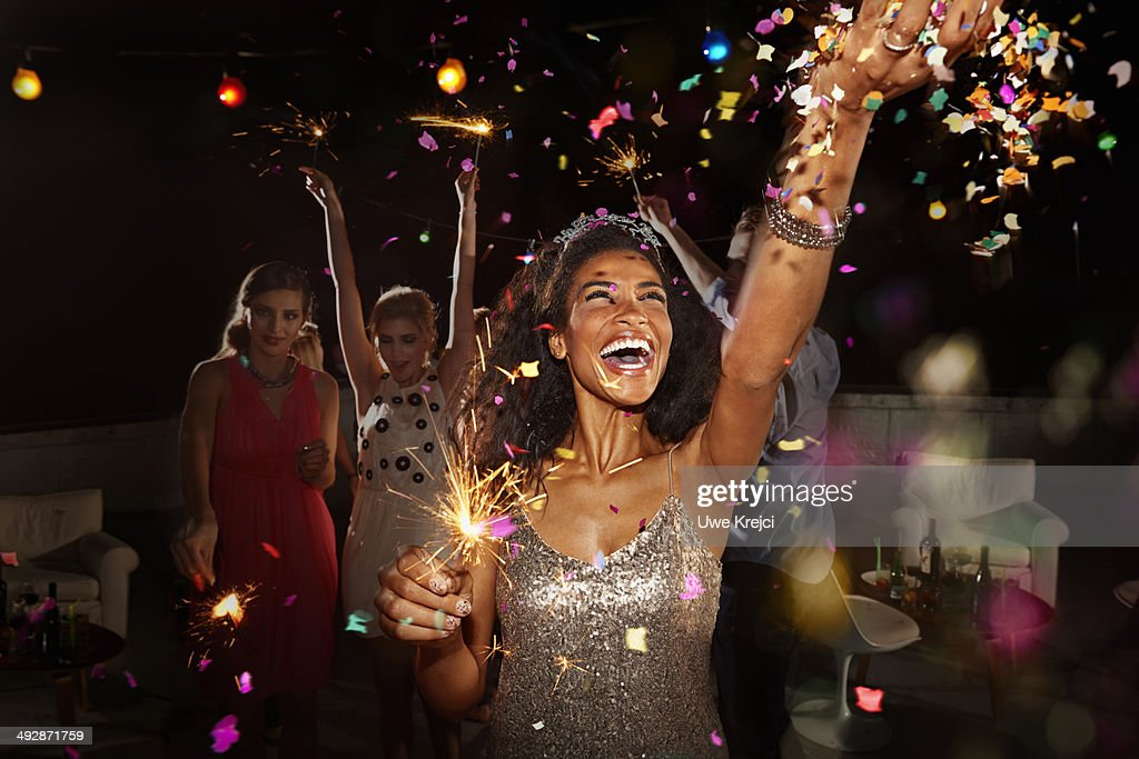 Friends celebrating at New Year's Eve party : Stock Photo